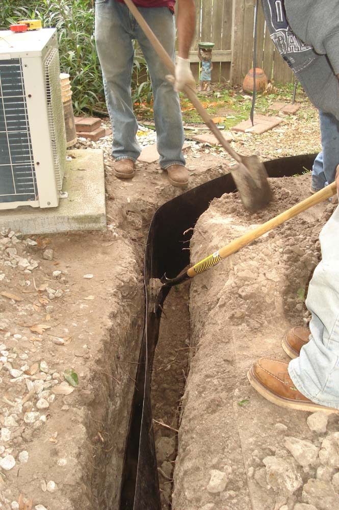 Back-Filling the Trench during a foundation repair job in Plano Texas